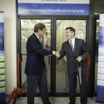 Lt. Governor Jim Cawley and Dr. John A. Bennett shaking hands after the ribbon had been cut.