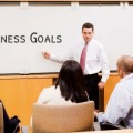 business-meeting-team-whiteboard-session-iStock_000004032661_ExtraSmall